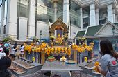 BANGKOK - JAN 2014:  People pray respect the shrine of the four-faced Brahma statue