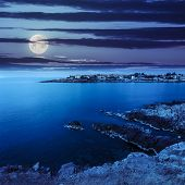 Ancient City On A Rocky Shore Near Sea At Night