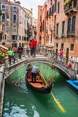 Tourists Travel On Gondolas At Canal