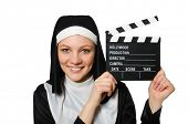 pic of nun  - Nun with movie board isolated on white - JPG