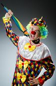 Funny clown with colourful umbrella