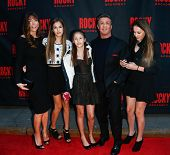 NEW YORK-MAR 13: Jennifer Flavin (L), Sylvester Stallone (2nd R) and daughters Sophia, Sistene, and Scarlet attend 'Rocky' Broadway opening night at Winter Garden on March 13, 2014 in New York City.