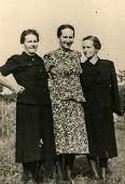 GERMANY, JULY 23, 1949 - Vintage photo of three women outdoor