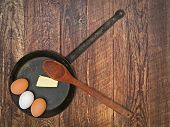 Vintage Set For Frying Eggs Over Wooden Table