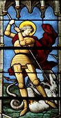 PARIS, FRANCE - NOV 11, 2012: Saint George slaying the dragon, stained glass. The Church of St Sever