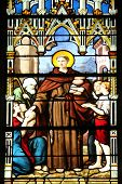 PARIS, FRANCE - NOV 11, 2012: Saint Anthony distributes bread, stained glass.The Church of St Severi