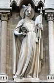 PARIS,FRANCE - NOV 05,2012: Allegories, The Church,architectural detail of Cathedral Notre Dame de P