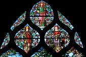PARIS,FRANCE - NOV 11,2012:Holy bishop (Lazarus?), St. Martha, Christ, stained glass.The Church of S