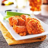 boneless buffalo chicken wings with celery and ranch