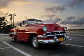 HAVANA, CUBA - NOVEMBER 3, 2009: View of red classic vintage american car parked, commonly used as p
