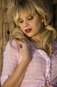 Beautiful blonde model in a pink blouse
