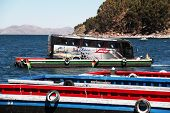 Tiquina, Bolivia - September 28, 2010: Bus crossing lake Titicaca on a raft while passangers take th