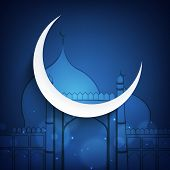 Beautiful crescent moon on blue mosque background for Muslim community festival Eid Mubarak celebrat