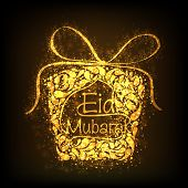 Floral decorated golden gift box on brown background for Muslim community festival Eid Mubarak celeb