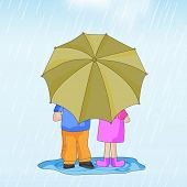 Cute couple under umbrella, enjoying rain.