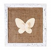 Wooden frame with paper butterfly isolated on white