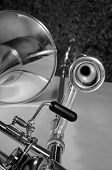foto of trombone  - Trombone against the background of a cork cladded studio wall - JPG