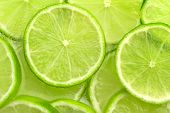 sliced lime in sparkling water