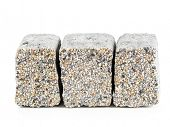 Three concrete pavement block with mineral topping shot on white