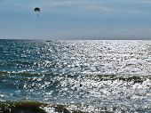 Parachutists over the sea