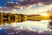 Fantastic panorama of morning lake with cumulus cloud. Ukraine, Europe. Beauty world.