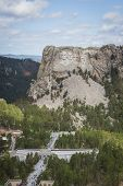 image of mount rushmore national memorial  - aerial view of Mount Rushmore on a cloudy spring morning - JPG