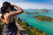 Tourist woman taking photo of tropical islands in Ko Angthong marine park, Thailand
