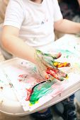 pic of finger-painting  - Little boy painting with colorful finger - JPG