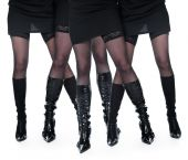 Picture of four female legs in lace stocking.