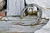 Horseshoe On A Rustic Wall