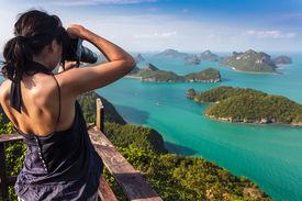 stock photo of marines  - Tourist woman taking photo of tropical islands in Ko Angthong marine park - JPG