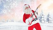 Smiling santa playing electric guitar against snowy landscape with fir trees