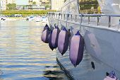 picture of yanks  - a number of bumpers hanging from the side of a yacht - JPG