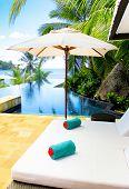 Palms Umbrellas Near Pool