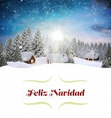 Christmas greeting card against snow covered village in forest