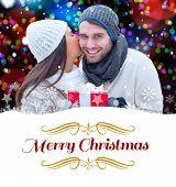 winter couple holding gift against border