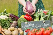 picture of farmers  - Healthy New Year against vegetables at farmers market - JPG