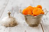 Dried Apricots In Silver Bowl