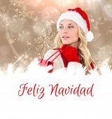happy festive blonde with shopping bag against feliz navidad