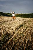Young Beautiful Free Happy Woman Jumps Happy With Smile