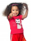 Cute african american small girl pointing to the camera and laughing isolated on white