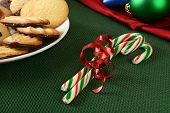 stock photo of shortbread  - Candy canes in a bowl with gourmet chocolate dipped shortbread cookies - JPG