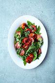 Cherry tomato and arugula salad