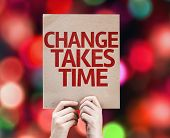 Change Takes Time card with colorful background with defocused lights