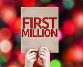 First Million card with colorful background with defocused lights