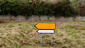 Blank direction signs in the village