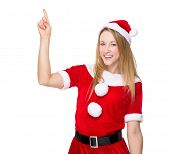 Xmas girl with finger pointing up