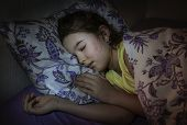 Little girl is sleeping well in her bed. Toned photo