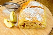 Strudel apple with strainer on board