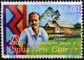 PAPUA NEW GUINEA - CIRCA 2006: A stamp pritned in Papua shows Canadian Dr. Jim Dean